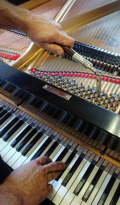Louis Gentile tuning a piano