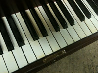 Restored H.F. Miller grand, keyboard closeup